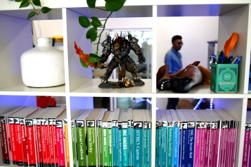 A peak through the office library towards the break room.